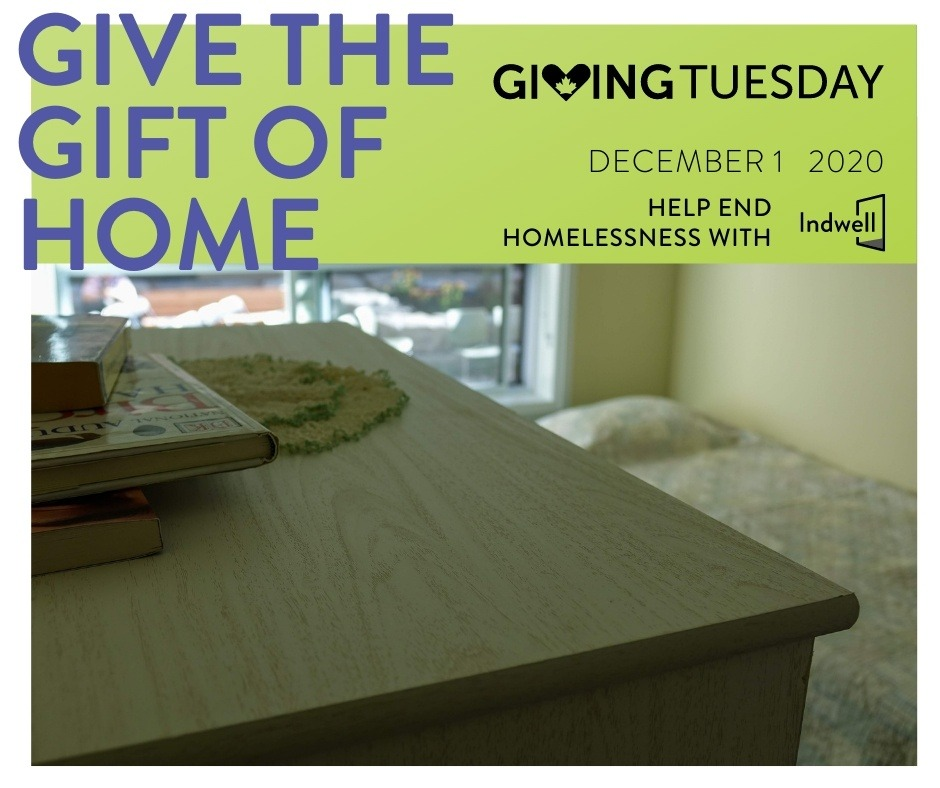 Give the Gift of Home - Giving Tuesday - 2020 - with table and books in the foreground, bed in background