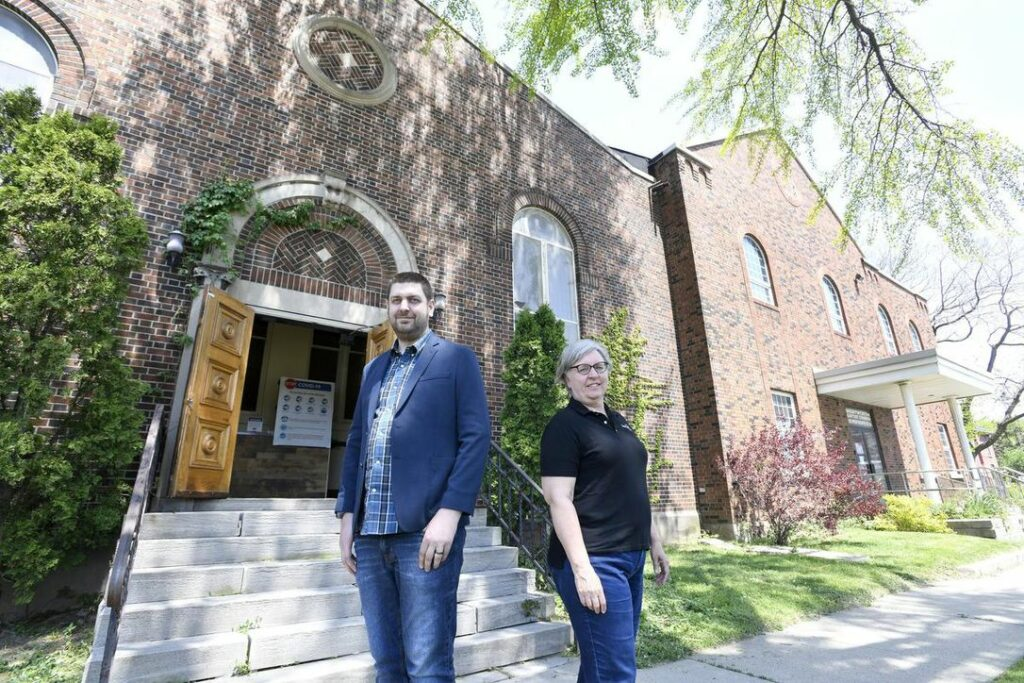 Sean McGuire, pastor, and Teresa Howe (Indwell) standing in front of Wentworth Baptist Church building