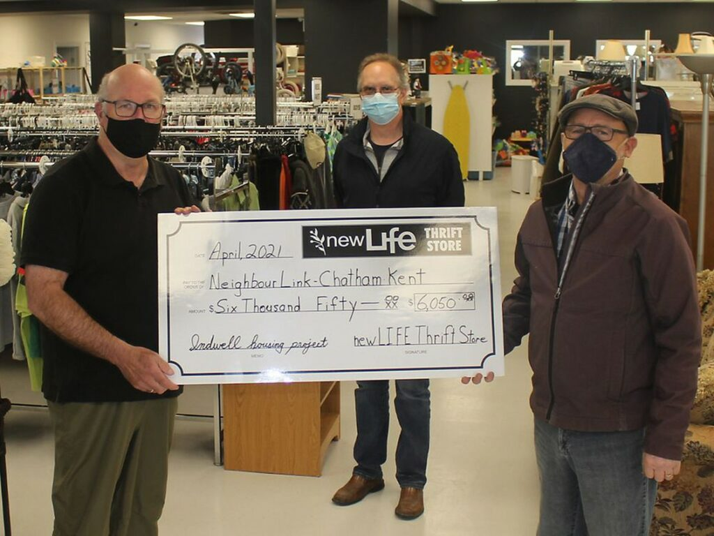Representatives from Neighbourlink receive large cheque from New Life Thrift Store, Chatham for future Indwell affordable housing